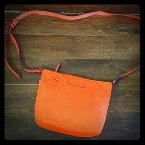 Vera Bradley orange crossbody purse .